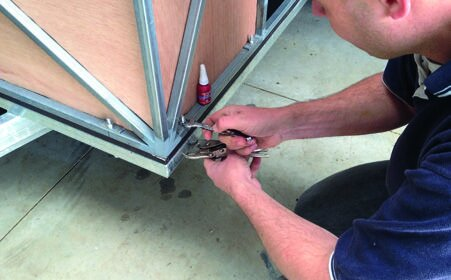 M8 bolts secure frame to chassis