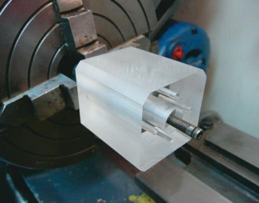 Clear cylinder block mounted on mandrel