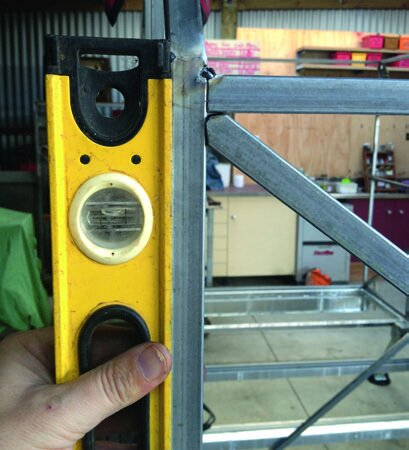 Level and clamp frame for welding