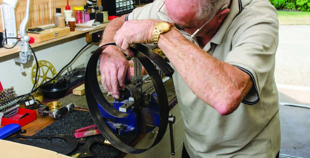 Fitting the clock spring into the spring winder—another tool Brian has built for himself